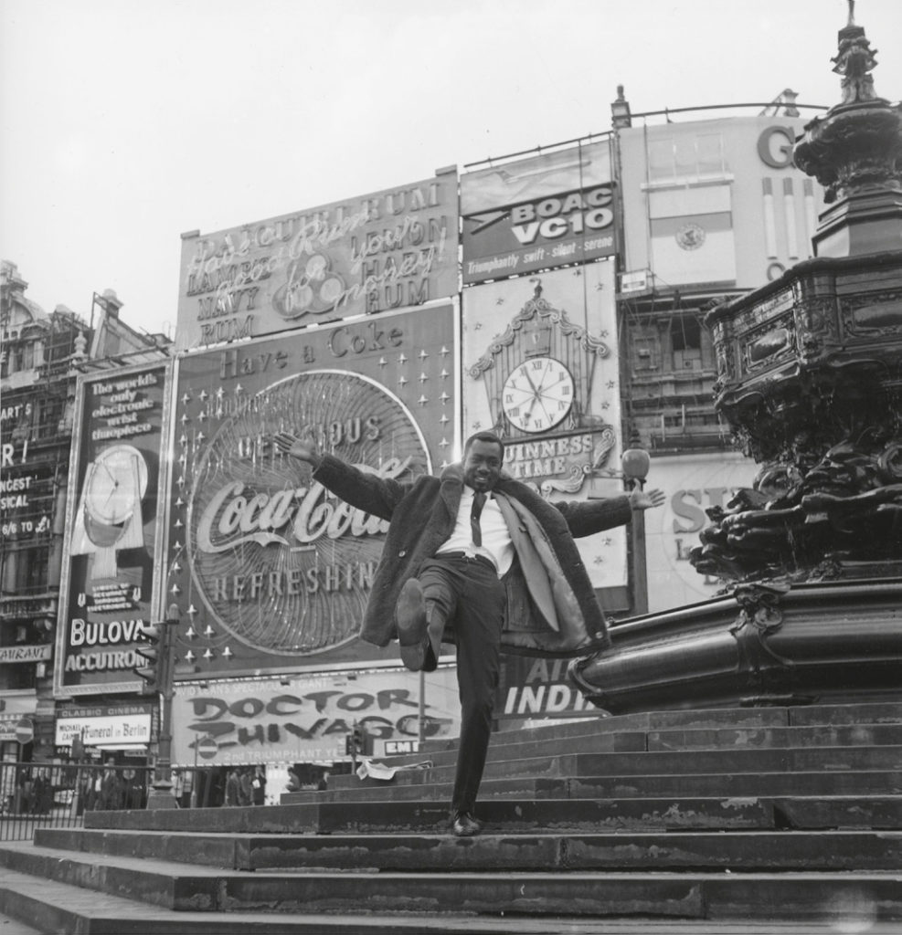 James Barnor   Mike Eghan at Piccadilly Circus, 1967  Silver print Signed James Barnor 40 x 50 cm